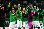 Team members of Bremen celebrate after the Bundesliga match between SV Werder Bremen and Bayer 04 Leverkusen at Weserstadion on February 8 2015 in...
