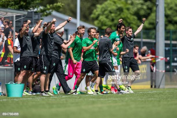 Team members of Bremen celebrate after winning the B Juniors German Championship Semi Final match between Borussia Dortmund and Werder Bremen on June...