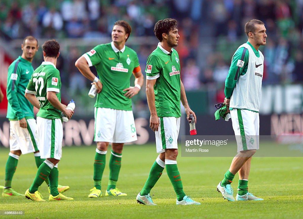 Team members of Bremen look dejected after the Bundesliga match between SV Werder Bremen and SC Freiburg at Weserstadion on October 4 2014 in Bremen...
