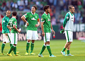 Team members of Bremen look dejected after the Bundesliga match between SV Werder Bremen and SC Freiburg at Weserstadion on October 4 2014 in Bremen...