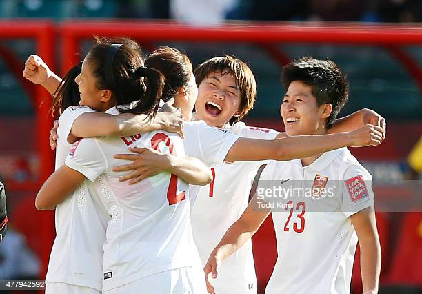 Team members of China celebrate their win over Cameroon during the FIFA Women's World Cup Canada Round 16 match between China and Cameroon at...