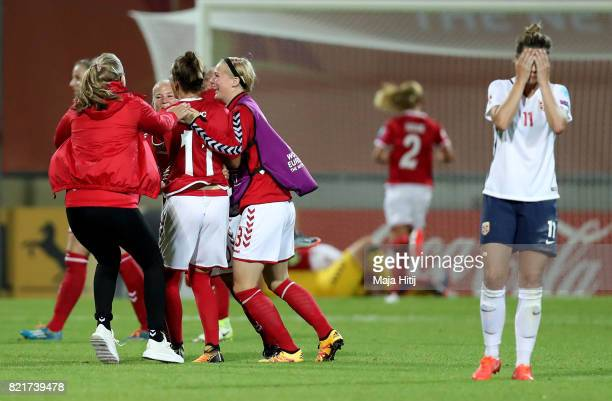 Team members of Denmark celebrate victory over Norway after the Group A match between Norway and Denmark during the UEFA Women's Euro 2017 at Stadion...