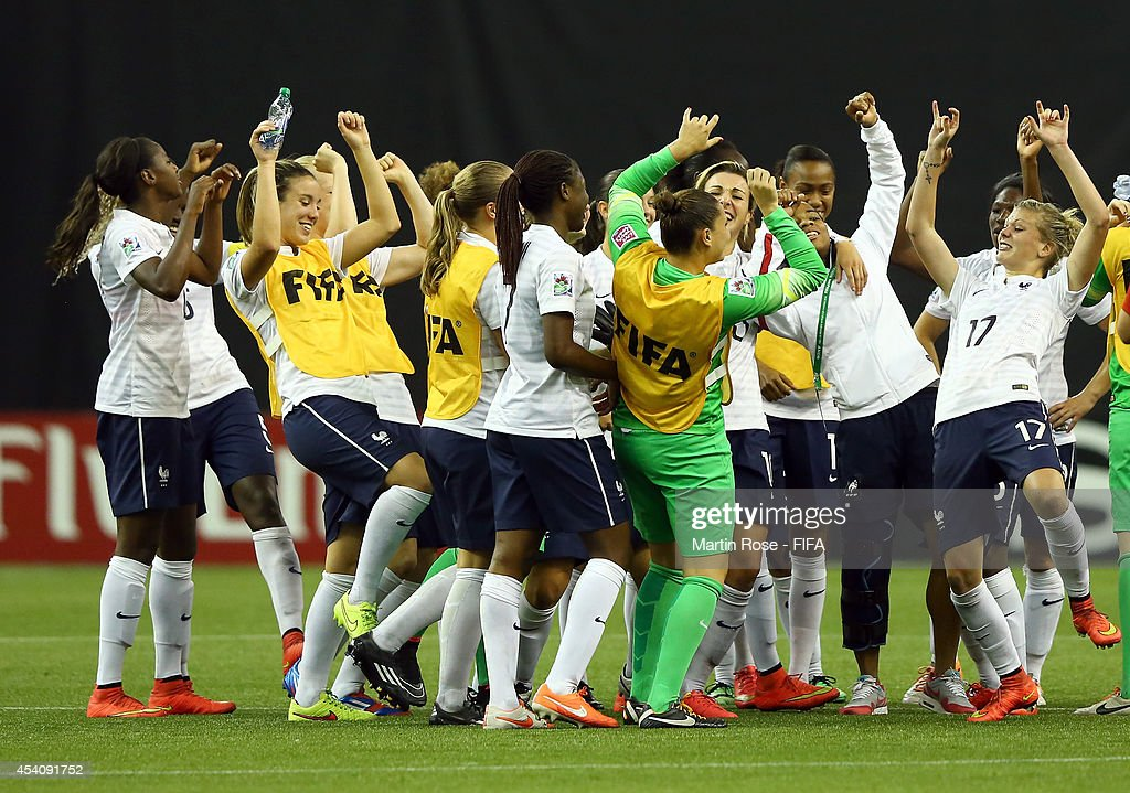 Team members of France celebrate after winning the FIFA U-20 Women's World Cup 2014 3rd place playoff match between Korea DPR and France at Olympic Stadium on August 24, 2014 in Montreal, Canada.