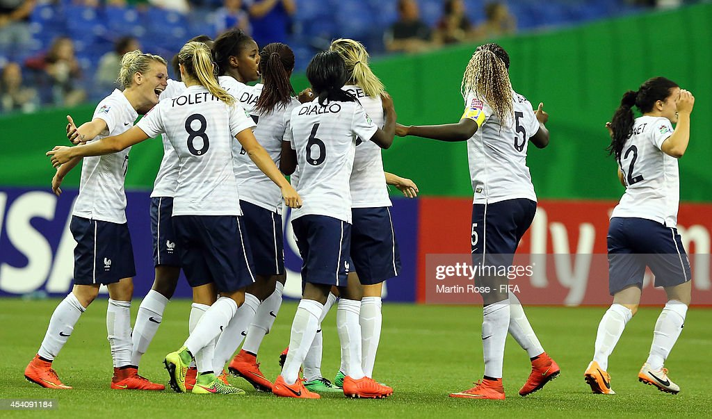 Team members of France celebrate their 3rd goal during the FIFA U-20 Women's World Cup 2014 3rd place playoff match between Korea DPR and France at Olympic Stadium on August 24, 2014 in Montreal, Canada.