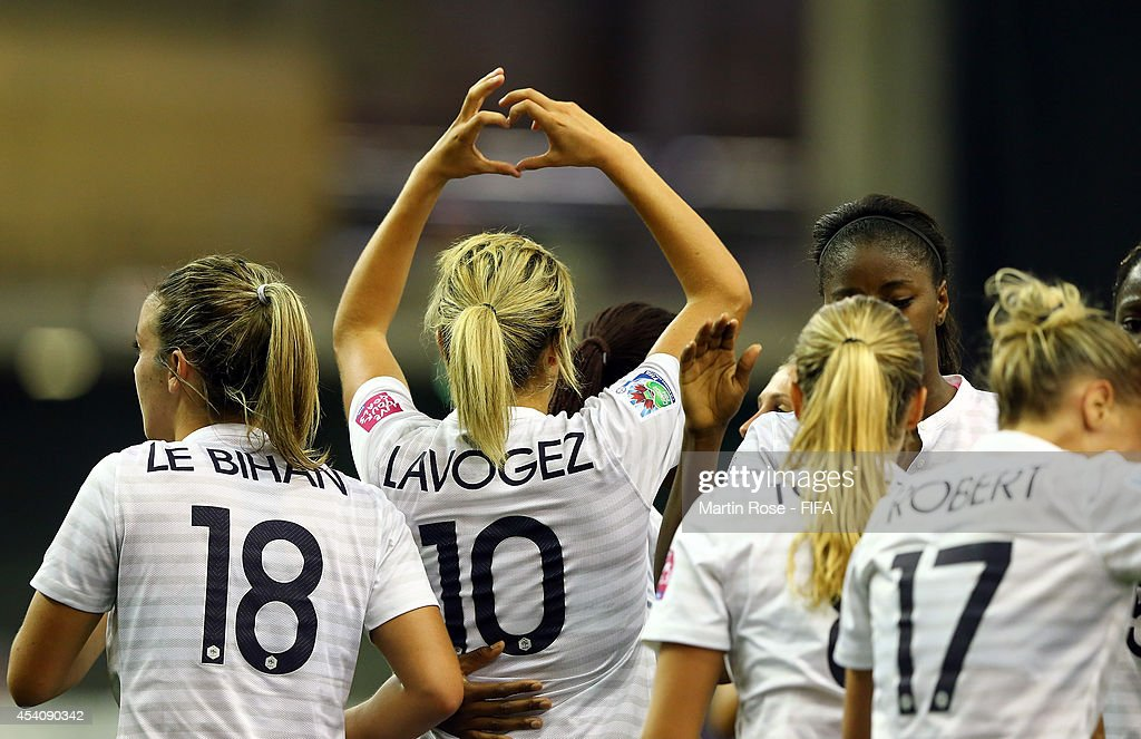 Team members of France celebrate their equalizing goal during the FIFA U-20 Women's World Cup 2014 3rd place playoff match between Korea DPR and France at Olympic Stadium on August 24, 2014 in Montreal, Canada.