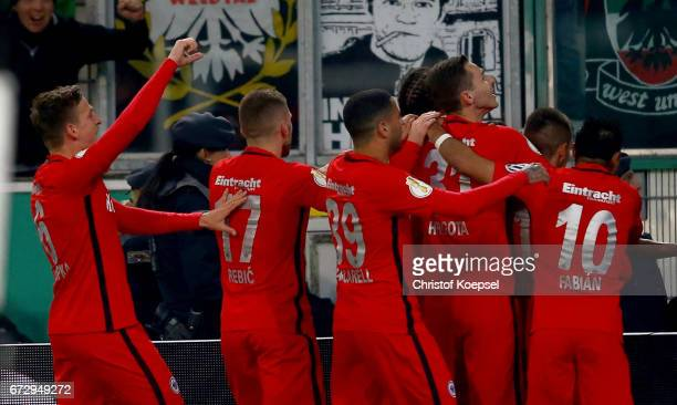 Team members of Frankfurt celebrate their opening goal during the DFB Cup semi final match between Borussia Moenchengladbach and Eintracht Frankfurt...