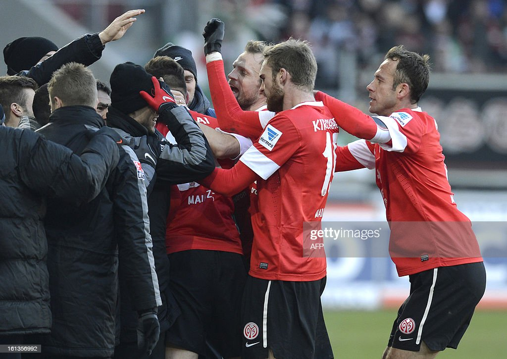 Team members of FSV Mainz 05 celebrate after the first goal for Mainz during the German first division Bundesliga football match between FC Augsburg and FSV Mainz 05 in Augsburg, southern Germany, on February 10, 2013.