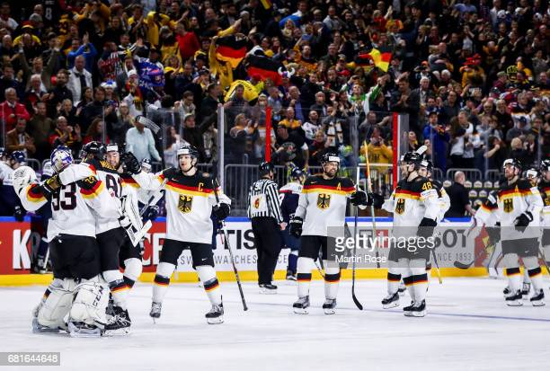 Team members of Germany celebrate after penalty shot out after the 2017 IIHF Ice Hockey World Championship game between Germany and Slovakia at...