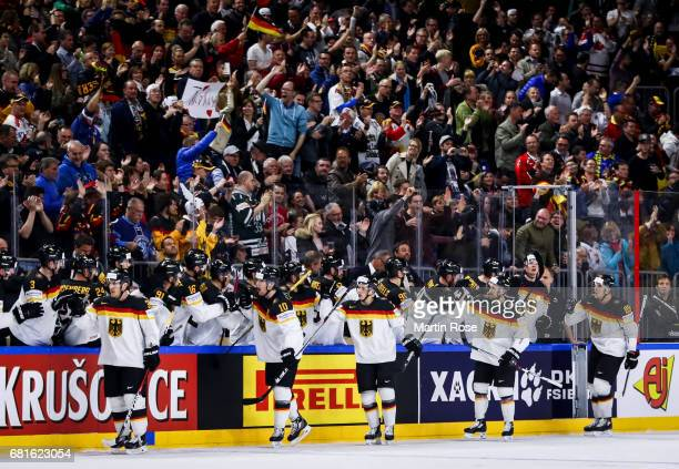 Team members of Germany celebrate after scoring a goal to make it 21 during the 2017 IIHF Ice Hockey World Championship game between Germany and...