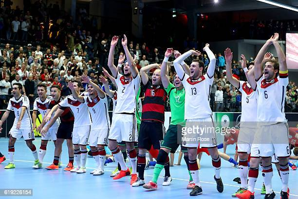Team members of Germany celebrate after the Futsal International Friendly match between Germany and England at Inselparkhalle on October 30 2016 in...