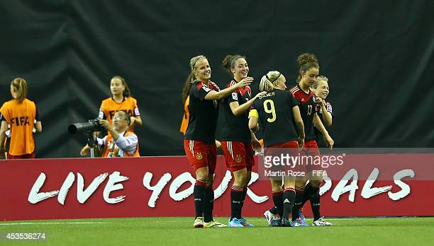 Team members of Germany celebrate their 3rd goal during the FIFA U20 Women's World Cup 2014 group B match between Brazil and Germany at Olympic...
