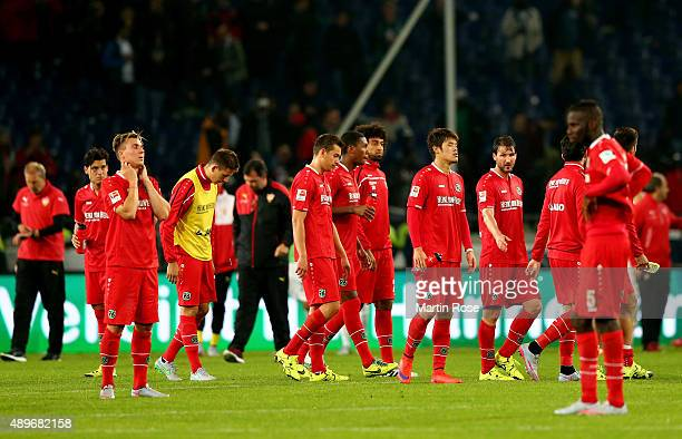 Team members of Hannover look dejected after the Bundesliga match between Hannover 96 and VfB Stuttgart at HDIArena on September 23 2015 in Hanover...