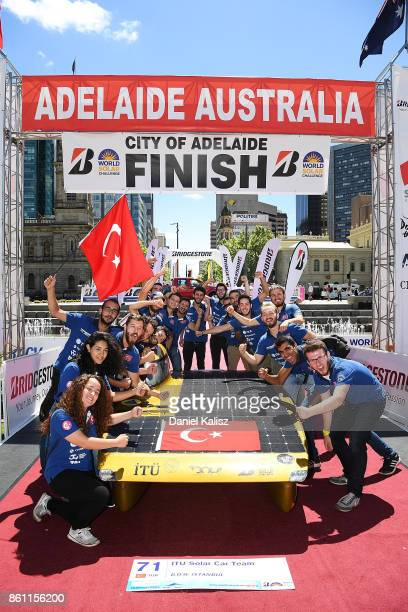 Team members of ITU Solar Car Team vehicle 'BOW ISTANBUL' from Turkey celebrate at the finish line on Day 7 of the 2017 Bridgestone World Solar...