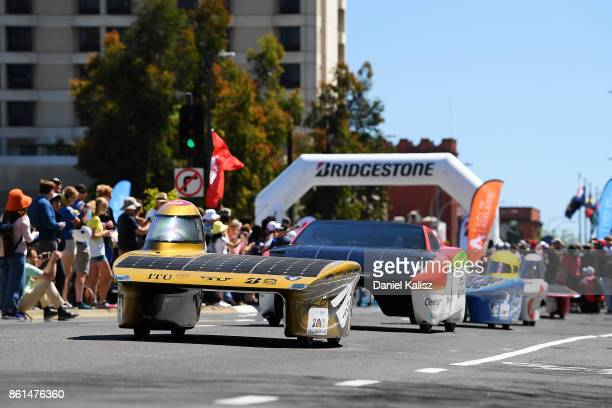 Team members of ITU Solar Car Team vehicle 'BOW ISTANBUL' from Turkey competes during a street parade for the 2017 Bridgestone World Solar Challenge...