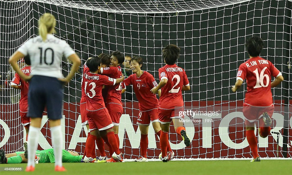 Team members of Korea DPR celebrate their 2nd goal during the FIFA U-20 Women's World Cup 2014 3rd place playoff match between Korea DPR and France at Olympic Stadium on August 24, 2014 in Montreal, Canada.