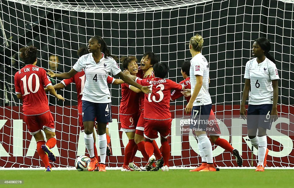 Team members of Korea DPR celebrate their opening goal during the FIFA U-20 Women's World Cup 2014 3rd place playoff match between Korea DPR and France at Olympic Stadium on August 24, 2014 in Montreal, Canada.
