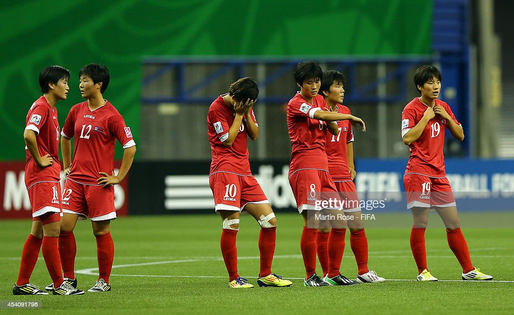 Team members of Korea DPR look dejected after losing the FIFA U-20 Women's World Cup 2014 3rd place playoff match between Korea DPR and France at Olympic Stadium on August 24, 2014 in Montreal, Canada.