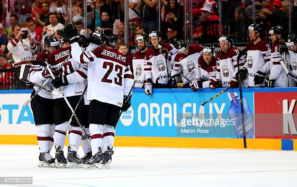 Team members of Latvia celebrate their equalizing goal during the IIHF World Championship group A match between Austria and Latvia at o2 Arena on May...