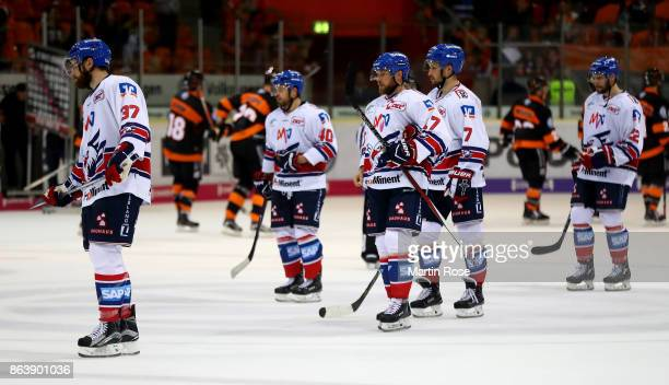 Team members of Mannheim skate off dejected after the DEL match between Grizzlys Wolfsburg and Adler Mannheim at Eisarena Wolfsburg on October 20...