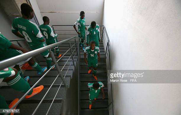 Team members of Nigeria walk to the pitch before the FIFA U17 Women's World Cup 2014 group D match between China and Nigeria at Alejandro Morera Soto...