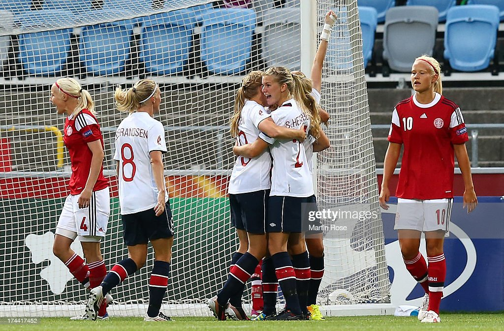 Team members of Norway celebrate their opening goal during the UEFA Women's Euro 2013 semi final match between Norway and Denmark at Nya Parken on July 25, 2013 in Norrkoping, Sweden.