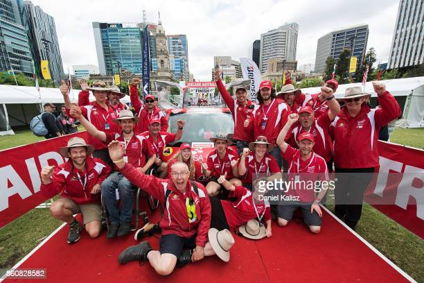 Team members of SAV the car from Australia's TAFE SA celebrate at the finish line on Day 6 of the 2017 Bridgestone World Solar Challenge at Victoria...