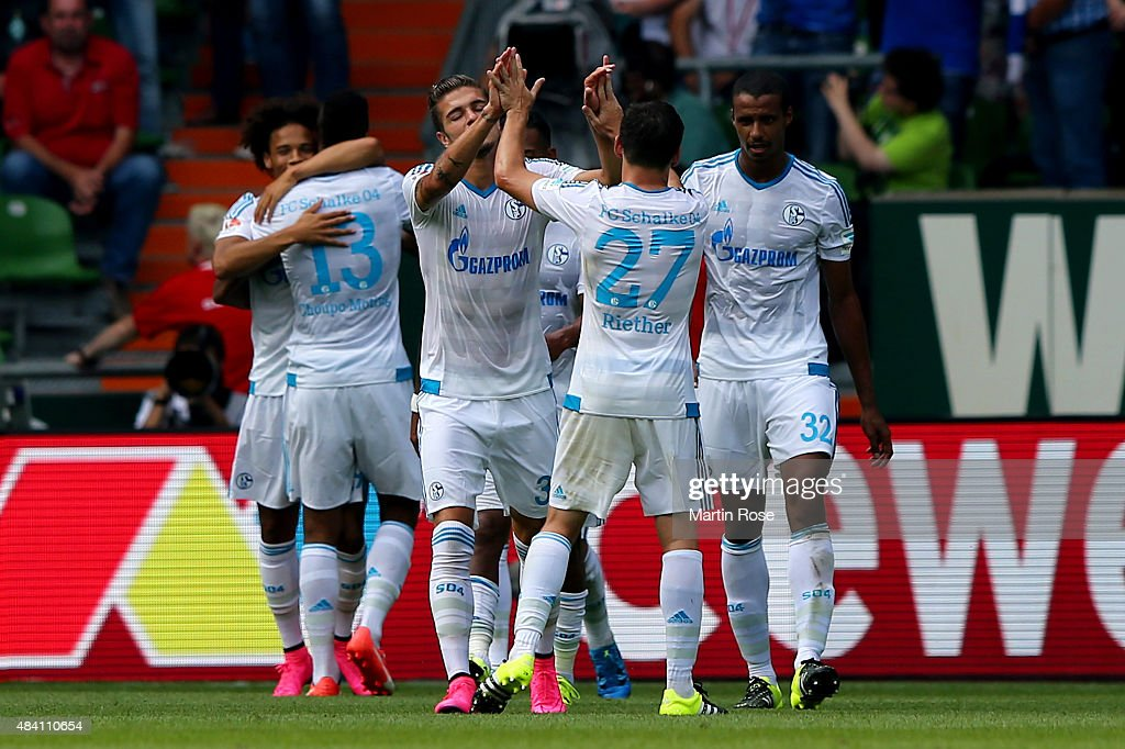 Team members of Schalke celebrate their 3rd goal during the Bundesliga match between SV Werder Bremen and Schalke 04 at Weserstadion on August 15, 2015 in Bremen, Germany.