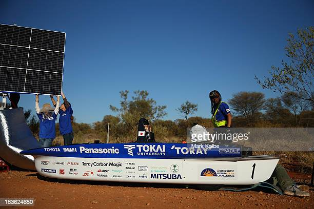 Team members of Tokai Challenger from Tokai University in Japan prepare their car to start racing on Day 3 on October 8 2013 outside of Ti Tree...