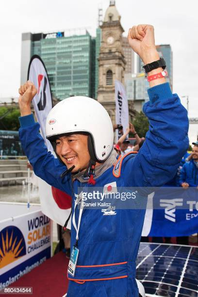 Team members of University Tokai Challenger vehicle 'Tokai' from Japan celebrate after crossing the finish line on Day 5 of the 2017 Bridgestone...