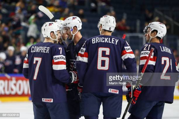 Team members of USA celebrate their opening goal during the 2017 IIHF Ice Hockey World Championship game between USA and Italy at Lanxess Arena on...
