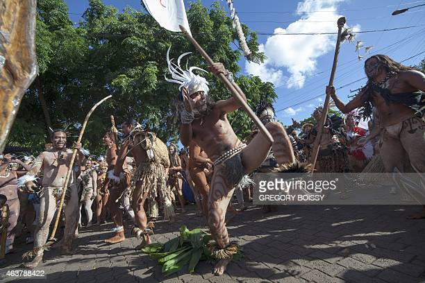 Team members participate in the festivities on February 12 2015 in Hanga Roa on Chile's Easter Island as people take part in the two week Tapati Rapa...