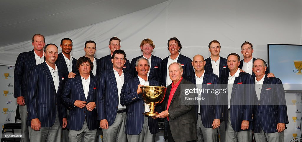 U.S. Team members (back row, L-R) Steve Stricker, Tiger Woods, Zach Johnson, Webb Simpson, Brandt Snedeker, Phil Mickelson, Jordan Spieth, Hunter Mahan (front row, L-R) Matt Kuchar, Jason Dufner, Keegan Bradley, Fred Couples, Jack Nicklaus, Bill Haas, Davis Love III and Jay Haas after the U.S. Team defeated the International Team 18.5 to 15.5 at Muirfield Village Golf Club on October 6, 2013 in Dublin, Ohio.