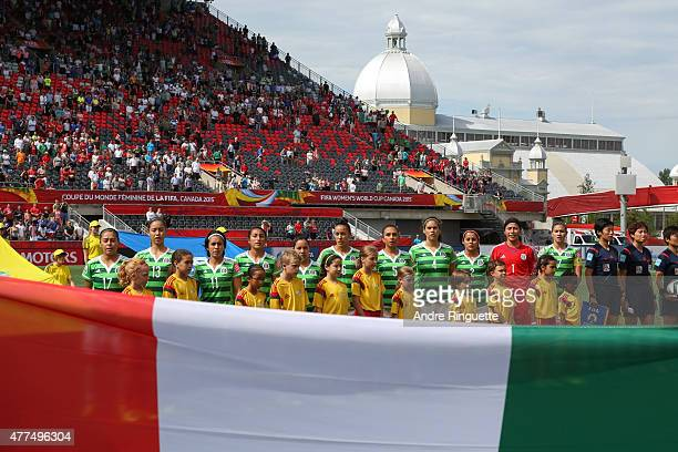 Team Mexico stands at attention during the singing of the national anthems prior to the FIFA Women's World Cup Canada 2015 Group F match between...