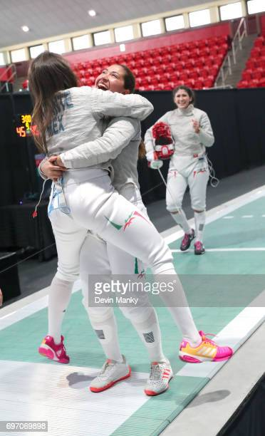 Team Mexico teamates Vanessa Infante and Ursula Gonzalez Garate hug in celebration after Paola Pliego scores the winning touch during the gold medal...