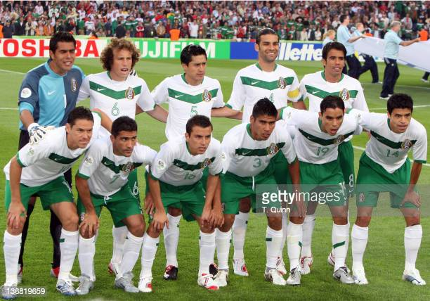 Team Mexico's starting eleven player pose before the game Mexico and Angola played to a 00 tie in their Group D match at FIFA World Cup Stadium in...