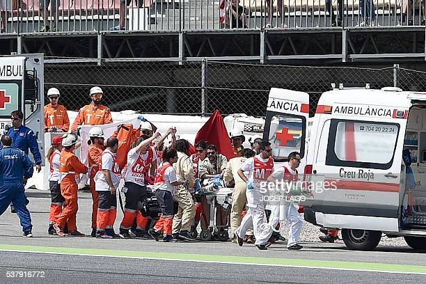 SAG Team Moto2 Spanish rider Luis Salom is evacuated by medical personnel after resulting injured in an accident at the Catalunya racetrack in...