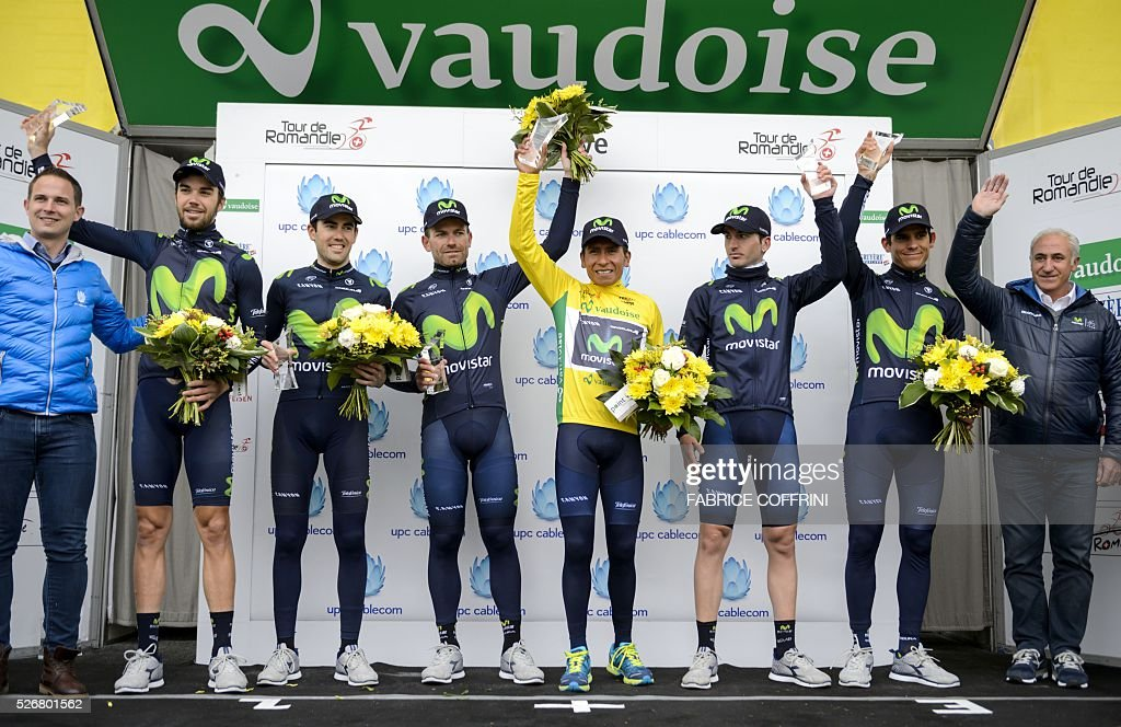 Team Movistar with winner of the race, Colombian Nairo Quintana (C) with his yellow jersey smile during the podium ceremony of the last stage of the 70th Tour de Romandie UCI World Tour, a 177,4 km race from Ollon to Geneva, on May 1, 2016 in Geneva. / AFP / FABRICE