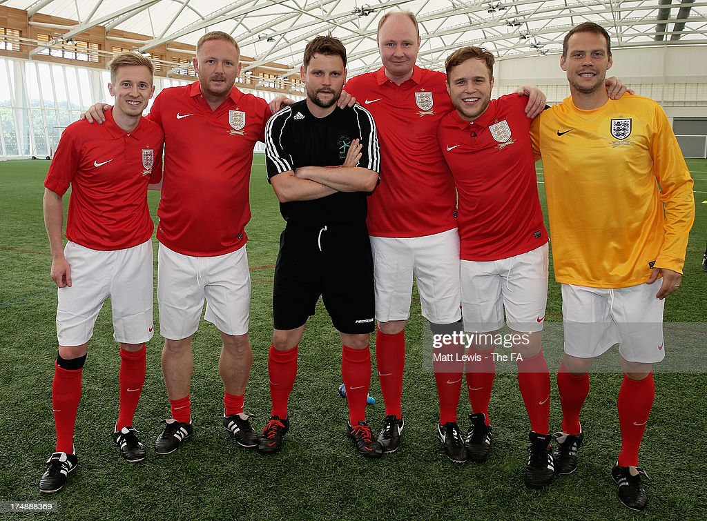 Team Murs captain <a gi-track='captionPersonalityLinkClicked' href=/galleries/search?phrase=Olly+Murs&family=editorial&specificpeople=6350751 ng-click='$event.stopPropagation()'>Olly Murs</a> (2nd R) lines up with David May (2nd L) and team-mates before the start of the BBC Radio 1 five-a-side football match between Team Grimshaw, captained by BBC Radio 1 DJ Nick Grimshaw and Team Murs, captained by singer and FA150 ambassador <a gi-track='captionPersonalityLinkClicked' href=/galleries/search?phrase=Olly+Murs&family=editorial&specificpeople=6350751 ng-click='$event.stopPropagation()'>Olly Murs</a>, at St Georges Park on July 29, 2013 in Burton-upon-Trent, England. In the build-up to Sir Bobby Robson National Football Day on August 10, the 5-a-side match was one of many events taking place around the country to mark The FA's 150th anniversary.