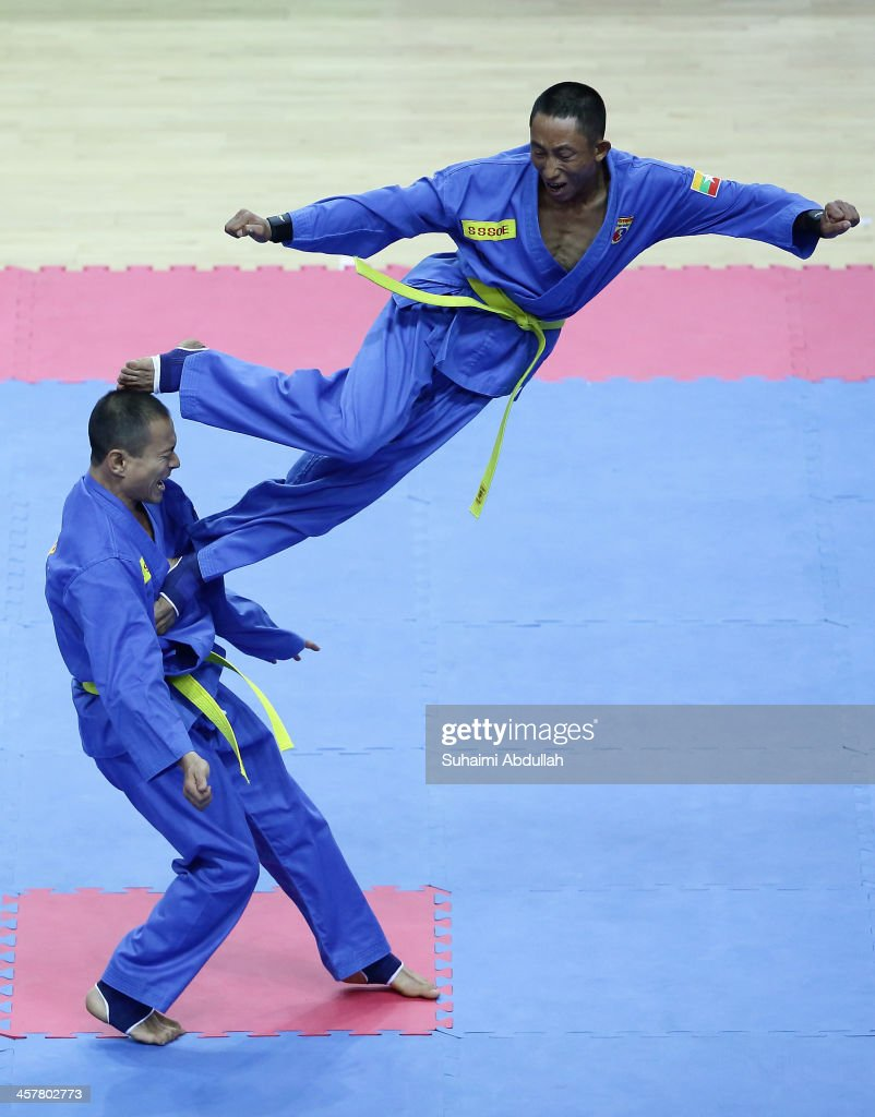 Team Myanmar competes in the Vovinam, Don Chan Tan Cong category during the 2013 Southeast Asian Games at Zayar Thiri Indoor Stadium A on December 19, 2013 in Nay Pyi Taw, Myanmar.