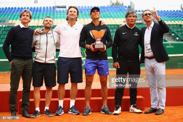 Team Nadal LR Agent Carlos Costa physio Rafael Maymocoach Carlos MoyaRafael Nadal with his 10th winners trophy coach Toni Nadal and PR Benito Perez...