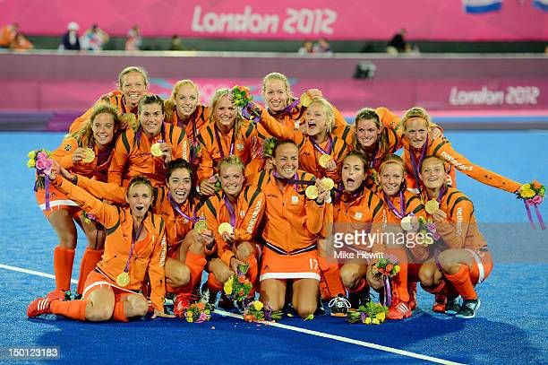 Team Netherlands celebrate with their gold medals during the medal ceremony after Women's Hockey on Day 14 of the London 2012 Olympic Games at Hockey...