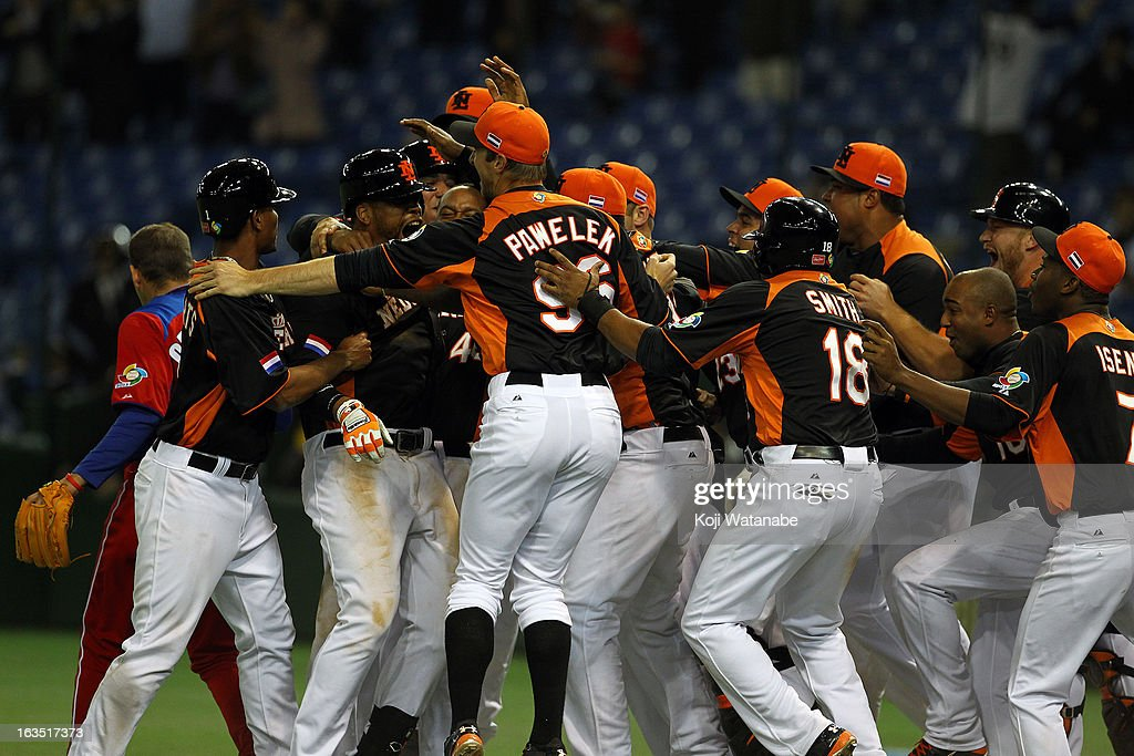 Team Netherlands celebrates after winning the World Baseball Classic Second Round Pool 1 game between against the Cuba at Tokyo Dome on March 11, 2013 in Tokyo, Japan.