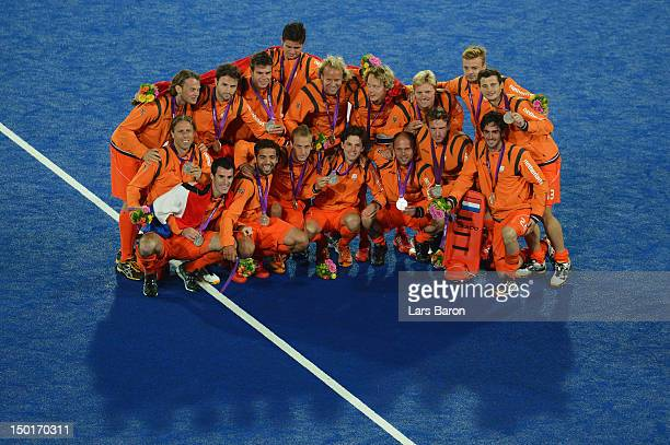 Team Netherlands celebrates with their silver medals after the medal ceremony following the Men's Hockey gold medal match against Germany on Day 15...