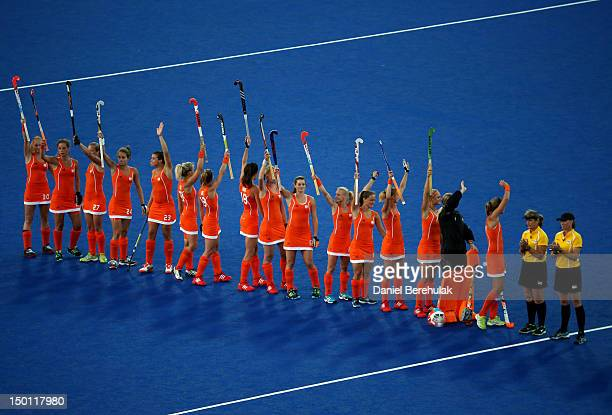 Team Netherlands respond to fans cheering before playing against Argentina during the Women's Hockey gold medal match on Day 14 of the London 2012...