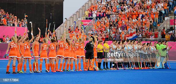 Team Netherlands respond to fans cheering before playing against team Argentina during the Women's Hockey gold medal match on Day 14 of the London...