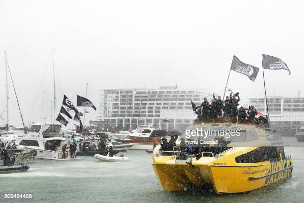 Team New Zealand make their way thought the huge flotilla on the harbour during the Team New Zealand Americas Cup Welcome Home Parade on July 6 2017...