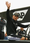 Team New Zealand skipper Dean Barker leaves the team base before racing was called off due to shifty conditions in Race 4 of the America's Cup...