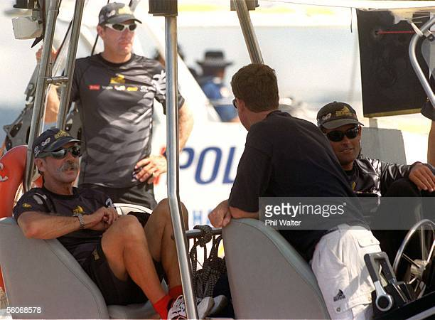 Team New Zealand's Tom Schnackenberg and Russell Coutts wait in vain on a tender boat for the wind to pick up on what was to be their first race...