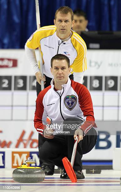 Team Newfoundland/Labrador skip Brad Gushue calls for a shot as Team Manitoba skip Jeff Stoughton watches over his shoulder in the 1 vs 2 Page...