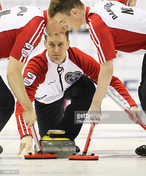 Team Newfoundland/Labrador skip Brad Gushue throws a rock in a game against Team Northern Ontario in the 2011 Tim Hortons Brier Canadian Men's...